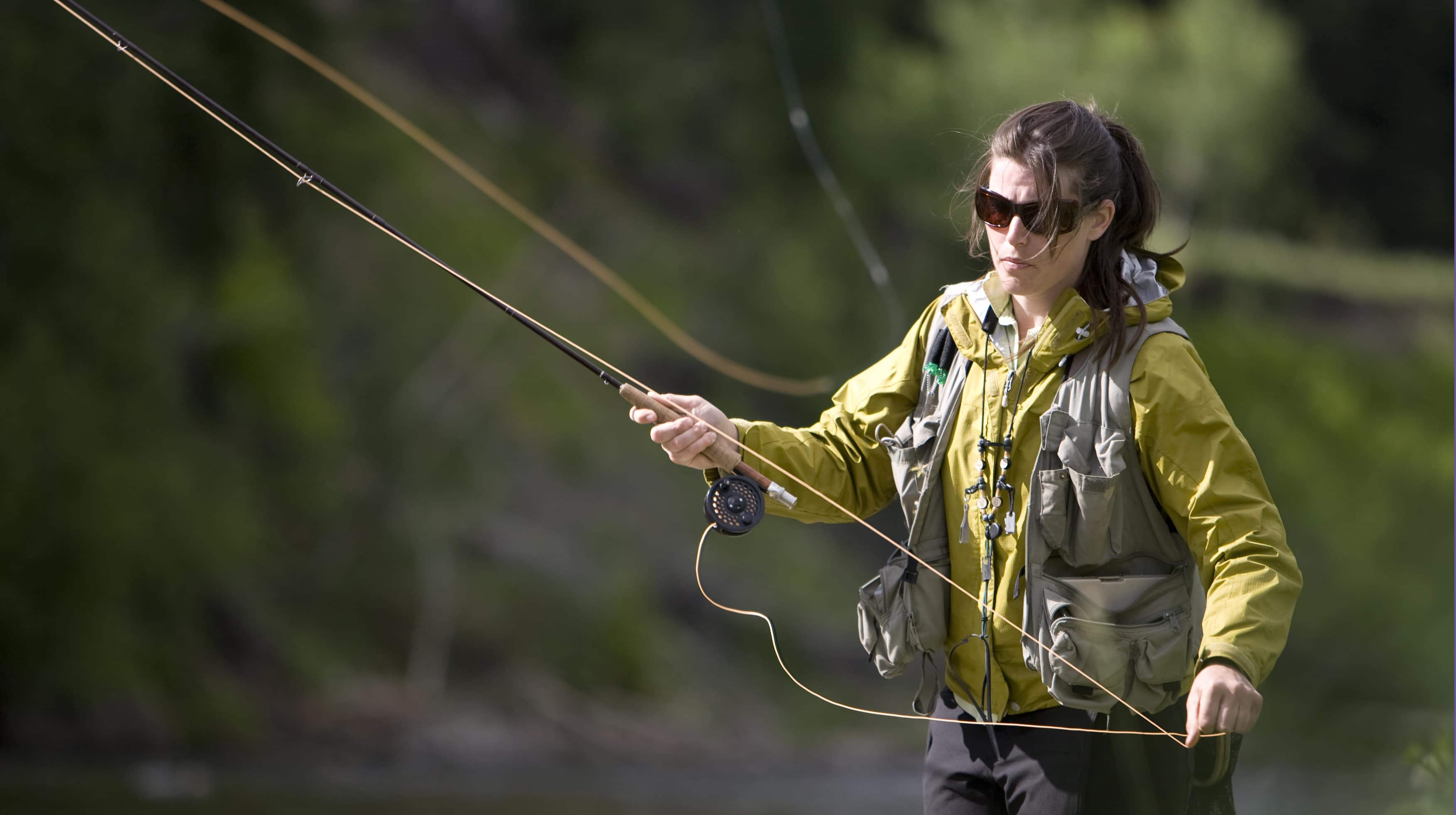 Woman fly fishing in British Columbia.